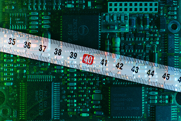 measuring how thick a printed circuit board's parylene coating will be